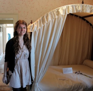 Near the replica bed